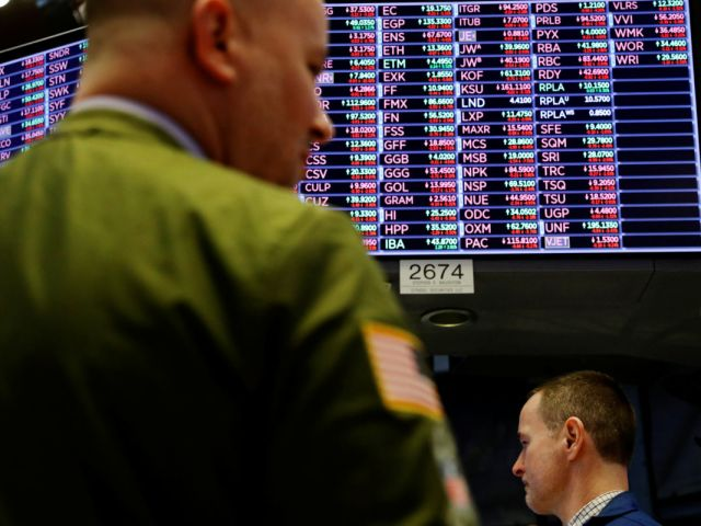 A trader works on the floor of the New York Stock Exchange shortly before the closing bell as the market takes a significant dip in New York