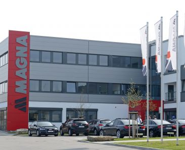 A man walks in front of a new plant of the international automotive supplier Magna in the Magna Exteriors & Interiors (Meerane) GmbH in Meerane, eastern Germany, Wednesday, April 24, 2013. THE CANADIAN PRESS/AP-Jens Meyer