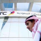 FILE PHOTO: A man passes the Saudi Telecom STC office in Riyadh, Saudi Arabia February 6, 2018. REUTERS/Faisal Al Nasser/File Photo