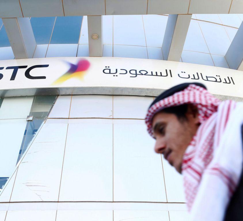 FILE PHOTO: A man passes the Saudi Telecom STC office in Riyadh